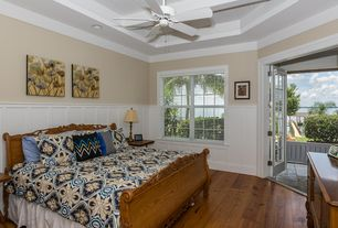 Traditional Master Bedroom with Wainscotting, High ceiling, Hardwood floors, Crown molding, Ceiling fan, Exposed beam