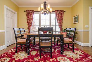 Country Dining Room with Hardwood floors, Casement, Chandelier, six panel door, Crown molding, Standard height, Chair rail