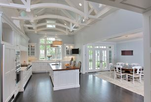 Traditional Kitchen with Wood counters, Pendant light, Kitchen island, Transom window, L-shaped, French doors, Custom hood