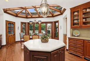 Country Kitchen with U-shaped, Pendant light, Framed Partial Panel, Casement, Limestone Tile, Skylight, Standard height