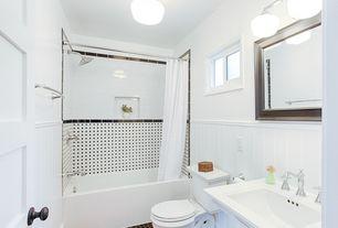 Traditional Full Bathroom with wall-mounted above mirror bathroom light, drop in bathtub, tiled wall showerbath, flush light