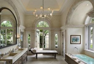 Traditional Master Bathroom with Wall sconce, French doors, Flush, Undermount sink, Master bathroom, limestone floors
