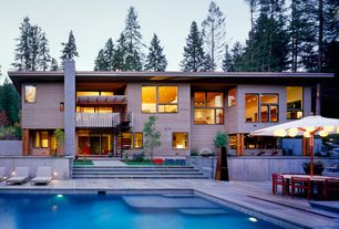 Contemporary Swimming Pool with exterior stone floors, Arbor, Lap pool, Pathway, Outdoor kitchen