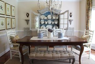 Traditional Dining Room with French doors, Chair rail, Laminate floors, Crown molding, Built-in bookshelf, Chandelier
