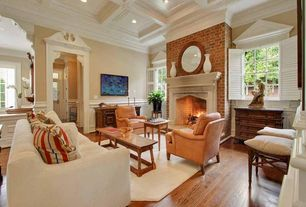 Traditional Living Room with Crown molding, Standard height, interior brick, Fireplace, brick fireplace, can lights