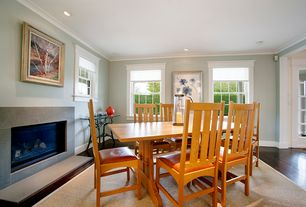 Traditional Dining Room with Cement fireplace, Crown molding, Hardwood floors