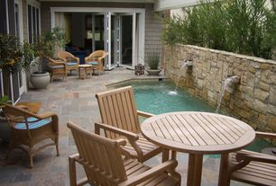 Cottage Patio with exterior stone floors, Fence, Fountain, French doors