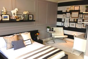 Contemporary Guest Bedroom with Chair rail, Crown molding, can lights, Carpet, Standard height, Built-in bookshelf