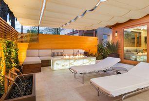 Modern Patio with Pathway, Fence, Fire pit, Fountain, sliding glass door, exterior concrete tile floors, exterior tile floors
