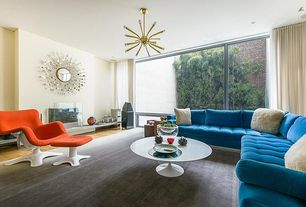 Modern Living Room with Chandelier, sandstone tile floors, Hardwood floors