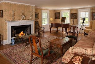 Traditional Living Room with Standard height, double-hung window, Crown molding, Fireplace, Hardwood floors, brick fireplace