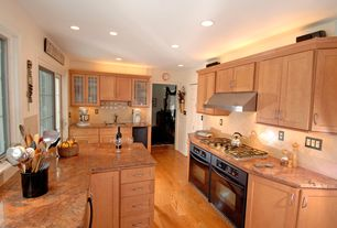 Modern Kitchen with Onyx counters, Flat panel cabinets, Undermount sink, Large Ceramic Tile, Flush, U-shaped, French doors