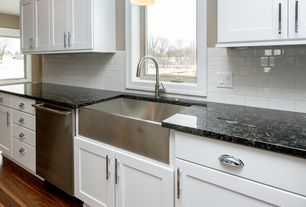 Modern Kitchen with Stainless steel apron sink, Inset cabinets, MS International Black Forest Granite, Pendant light