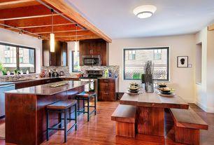 Modern Dining Room with Hardwood floors, flush light