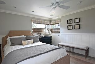 Cottage Guest Bedroom with Crown molding, Casement, Standard height, Chair rail, Ceiling fan, can lights, Hardwood floors