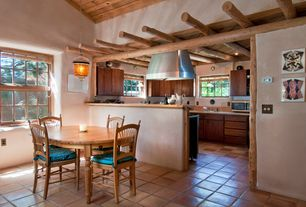 Rustic Dining Room with Wheat back side chair, Super saltillo terracotta floor tile - rounded edges, terracotta tile floors