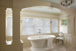 Traditional Master Bathroom with stone tile floors, Standard height, Master bathroom, Wall sconce, Columns, Chandelier