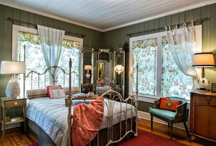 Cottage Guest Bedroom with Hardwood floors, Crown molding, Standard height