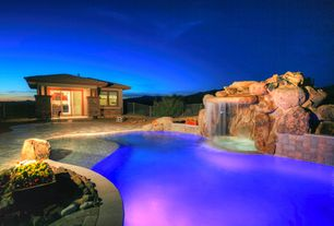 Rustic Swimming Pool with Deck Railing, exterior stone floors, Casement, Infinity pool, French doors, Fountain, Raised beds