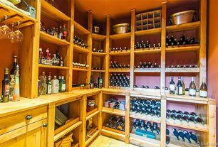 Country Wine Cellar with Built-in bookshelf, stone tile floors, Standard height, travertine tile floors
