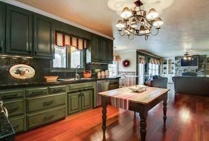 Traditional Kitchen with Kitchen island, flush light, Hardwood floors, Butcher block work table, Inset cabinets, Chandelier