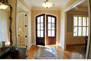 Traditional Entryway with French doors, Crown molding, Hardwood floors, Pendant light
