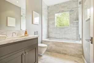 Contemporary Full Bathroom with Ms International  Carrara White Marble, limestone tile floors, Flush, tiled wall showerbath