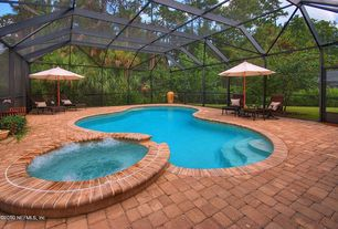 Traditional Swimming Pool with exterior brick floors, Skylight, exterior stone floors, Pool with hot tub, Fence, Indoor pool