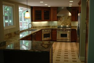 Traditional Kitchen with Wall Hood, Galley, Flat panel cabinets, wall oven, Complex granite counters, can lights, dishwasher