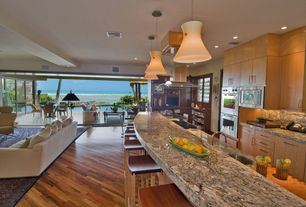 Contemporary Kitchen with Indoor/outdoor living, Undermount sink, Complex Granite, Tigerwood engineered hardwood flooring