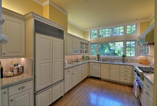 Traditional Kitchen with Flush, Glass panel, Simple granite counters, Standard height, U-shaped, Paint, Crown molding