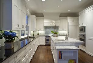 Traditional Kitchen with Framed Partial Panel, Large Ceramic Tile, Casement, can lights, Kitchen island, picture window