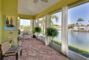 Tropical Porch with Screened porch, picture window, Wrought iron planter, Paint, exterior brick floors