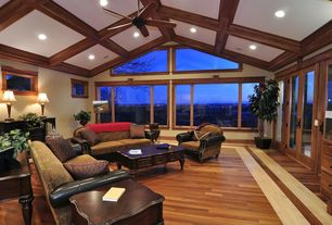 Craftsman Living Room with Simmons upholstery zephyr sofa, picture window, Exposed beam, can lights, Ceiling fan