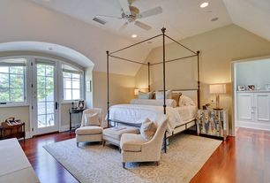 Traditional Guest Bedroom with Hardwood floors, can lights, Ceiling fan, French doors, Casement, High ceiling