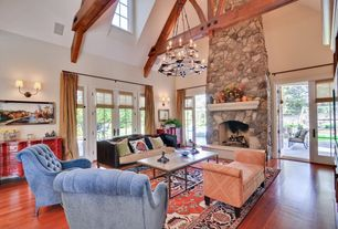 Contemporary Living Room with Chandelier, French doors, High ceiling, Wall sconce, Laminate floors, stone fireplace
