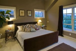 Modern Guest Bedroom with High ceiling, Hardwood floors, West elm upholstered sleigh bed set