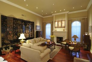 Traditional Living Room with Fireplace, insert fireplace, can lights, Arched window, Standard height, Laminate floors, Carpet
