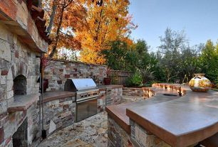 Contemporary Patio with exterior stone floors, Fence, Outdoor kitchen, outdoor pizza oven