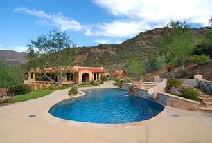 Mediterranean Swimming Pool with French doors, Raised beds, sliding glass door, exterior stone floors, Pool with hot tub