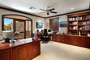 Traditional Home Office with Built-in bookshelf, Crown molding, Carpet, Art desk, Ceiling fan, Transom window