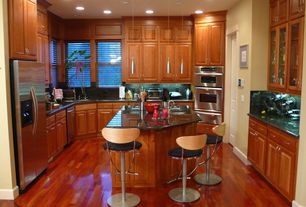 Traditional Kitchen with Breakfast bar, Simple Granite, full backsplash, specialty window, can lights, Built In Refrigerator