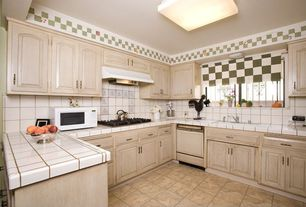 Country Kitchen with electric cooktop, Undermount sink, large ceramic tile counters, Standard height, stone tile floors
