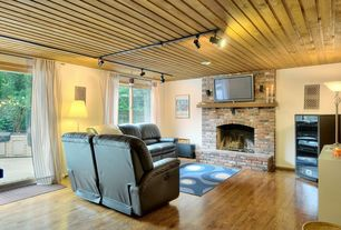 Cottage Living Room with Hardwood floors, can lights, picture window, brick fireplace, Fireplace, Standard height