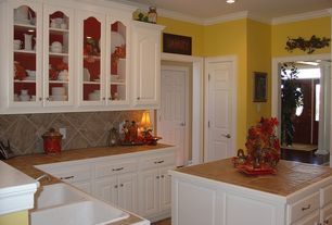 Traditional Kitchen with stone tile floors, Crown molding, Stone Tile, Kitchen island, can lights, drop-in sink, Raised panel