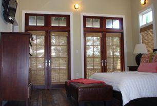 Craftsman Guest Bedroom with Hardwood floors, Transom window, Wall sconce, Shoji door