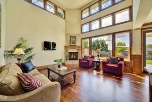 Craftsman Living Room with Hardwood floors, High ceiling, stone fireplace
