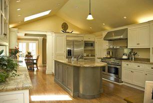 Traditional Kitchen with High ceiling, six panel door, Pendant light, Kitchen island, Wall Hood, Breakfast nook, U-shaped