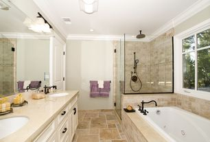 Traditional Full Bathroom with Crown molding, Danze tumbled bronze widespread bathroom faucet, flush light, Inset cabinets