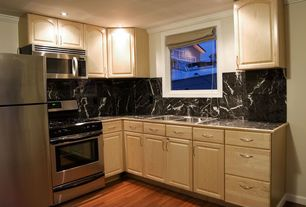 Traditional Kitchen with Bamboo floors, Daltile Marble Collection China Black Tile, Raised panel, Soapstone counters